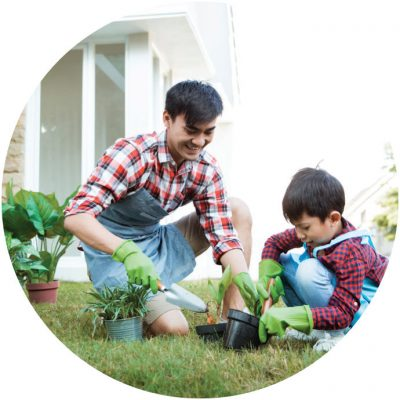 Father and son doing gardening